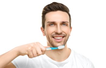 A man brushing his teeth.