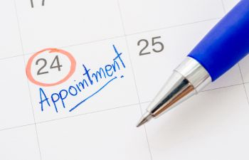 calendar with marked dental appointment