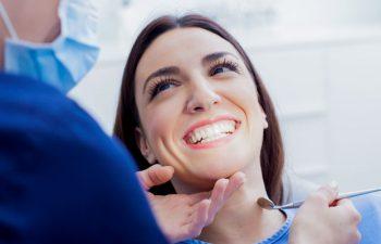 A woman in a dentist chair undergoing gum checkup