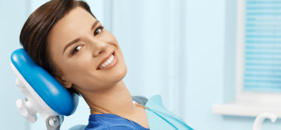 Relaxed smiling woman in a dental chair