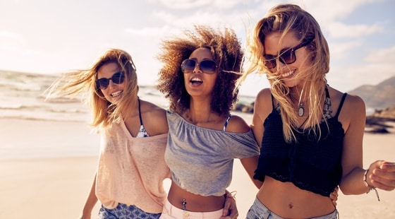 Three young women with perfect smiles